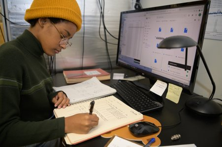 Female student works in a physics lab.