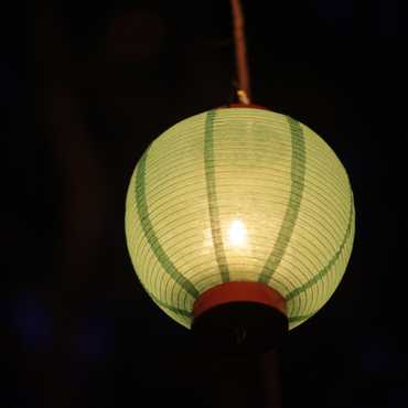 A close-up of a lantern at night