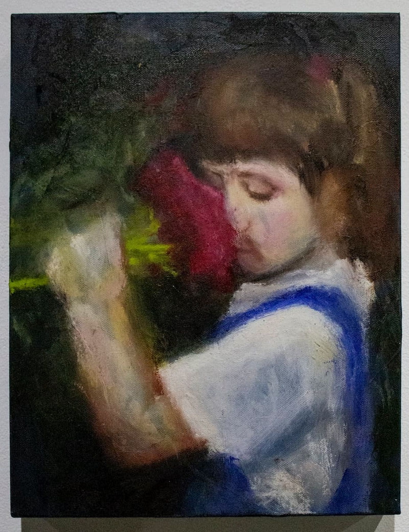 A pastel drawing of a child smelling a bought of flowers.