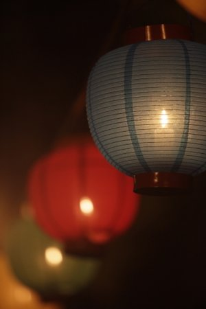 A close-up picture of a candle inside a lantern