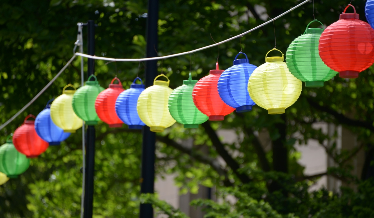 A long rope is filled with hanging lanterns.