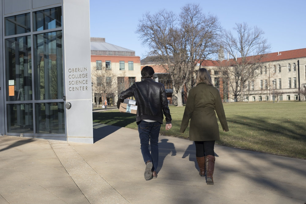 Two students walking next to the Science Center.