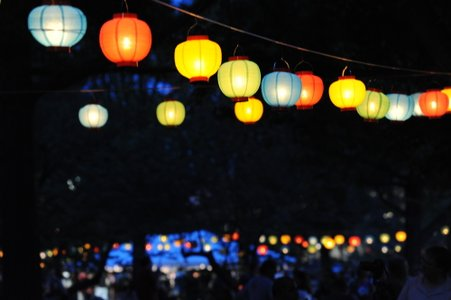 Hanging glowing lanterns in the dark