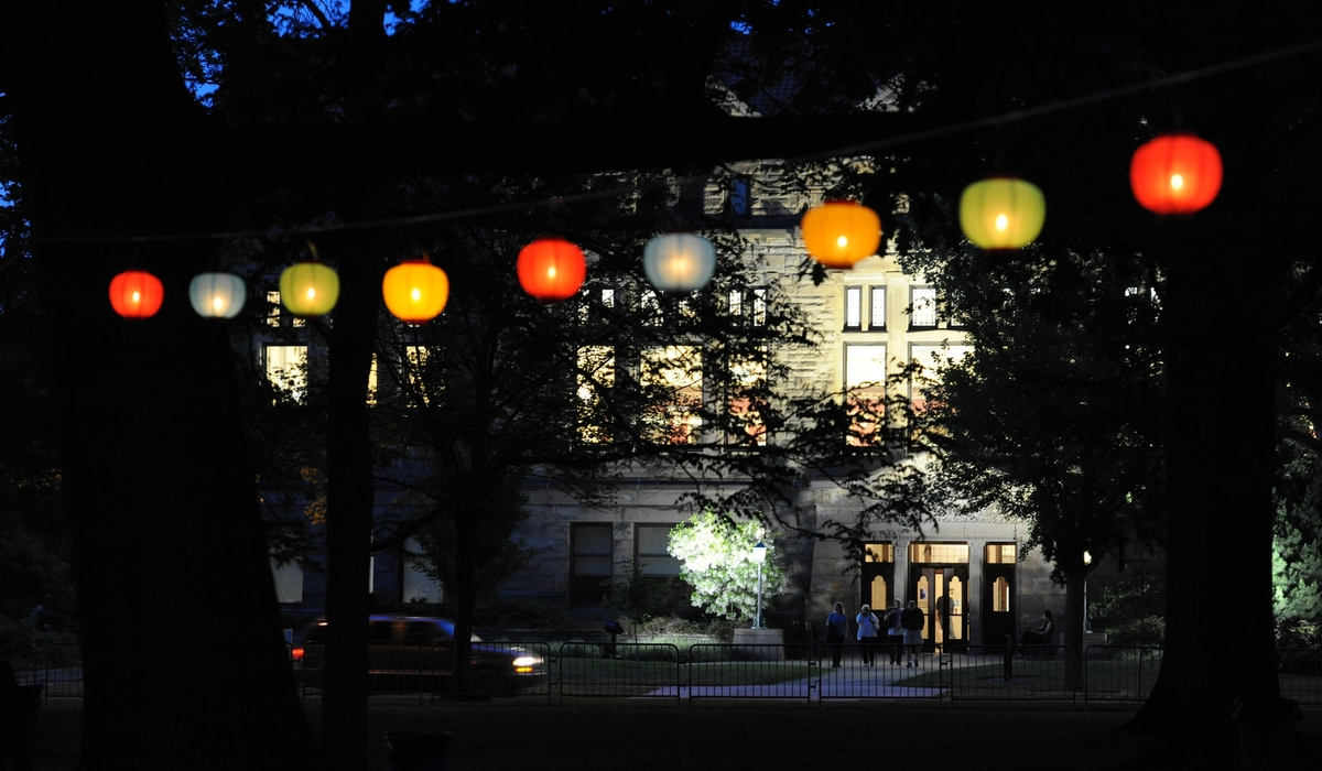 A building in the foreground of hanging lanterns