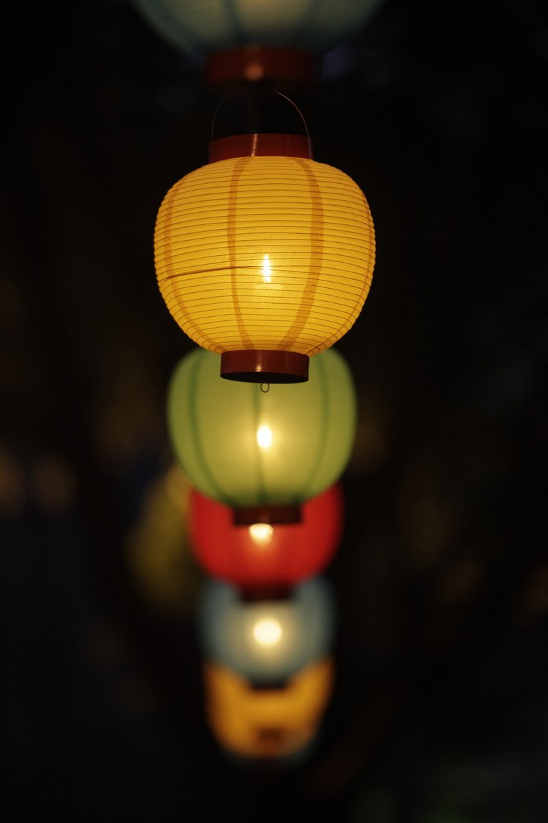 A row of lanterns in the dark