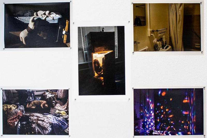 Five pictures showing a girl in a refrigerator, a bathroom, a girl half off a bed, a girl laying on the floor, and string lights.